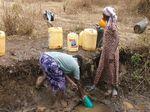 Ladies getting water